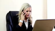 Upset business woman with laptop video