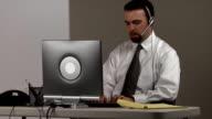 Upset businessman at desk video