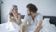 Upset couple talking in their bedroom video