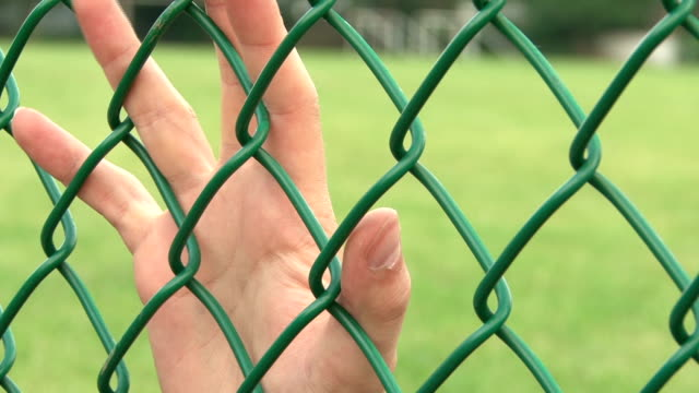 Upset Hands on Fence video