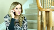 Upset woman talking on mobile phone video