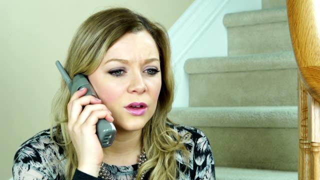 Upset woman talking on the phone video