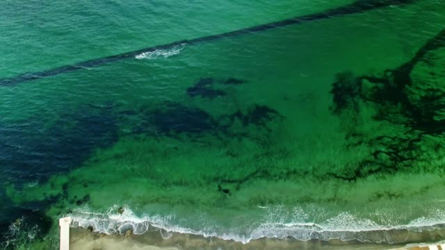 Upside down aerial of green colored sea and coastline video