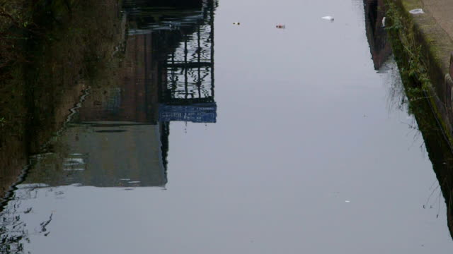 Urban Industrial Redbrick Buildings reflected in the rippling canal waters video