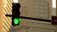 Urban traffic light changing from green to red video