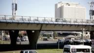 Urban traffic. Road and Bridge. Fast Playback video
