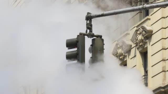 Usa new york summer day traffic street light in pipe smoke 4k video