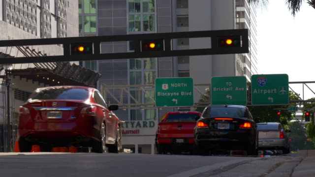 Usa summer day miami downtown traffic light crossroad 4k florida video