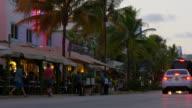 Usa summer sunset miami south beach ocean drive traffic street 4k florida video