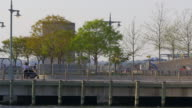 Usasummer day sunset light new york city east river pier 4k video