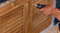 Use Electric drill to drill the wood door video