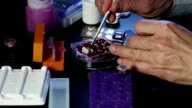 Use multi pipette in microbiology video