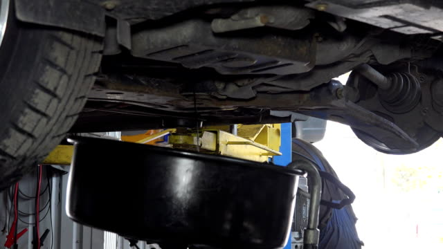 Used oil flowing into car oil replacement equipment reservoir video