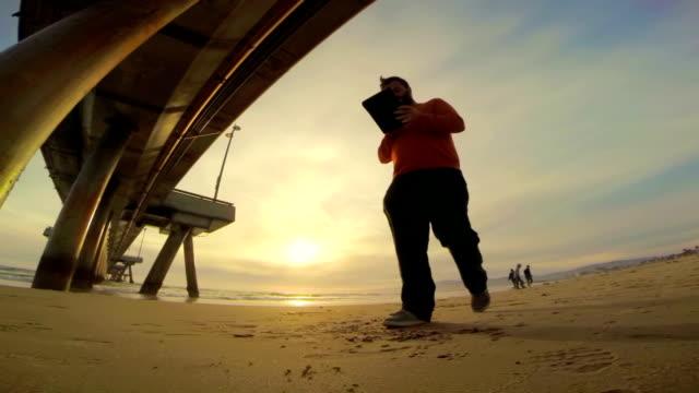 WS LA TS Using A Digital Tablet On Venice Beach video