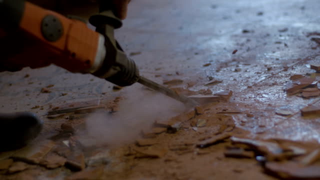 SLO MO Using a jackhammer for removing tiles video