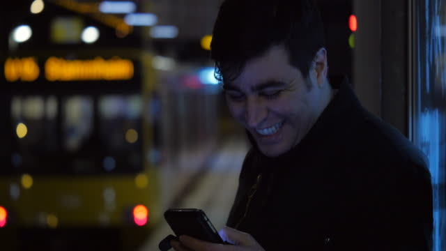 Using a Phone While Waiting for the Train video