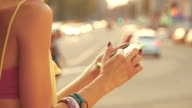 Using cellphone with defocused city traffic. video