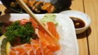 Using Chopstick eating Salmon Sashimi, Japanese Food video