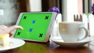 Using Digital Tablet PC in Coffee shop, 4K(UHD) video