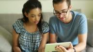 Using digital tablet together. video
