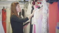 Using digital tablet while doing an inventory in the boutique video