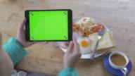 Using Green screen digital tablet with breakfast video
