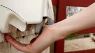 Using hand sanitizer at Farm video