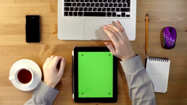 Using Laptop and Tablet PC with a Green Screen at the Desktop. video