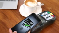 Using Mobile Phone payment at cafe, Contactless payment video