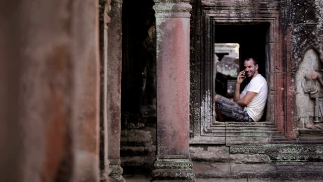 Using phone in Angkor Wat video