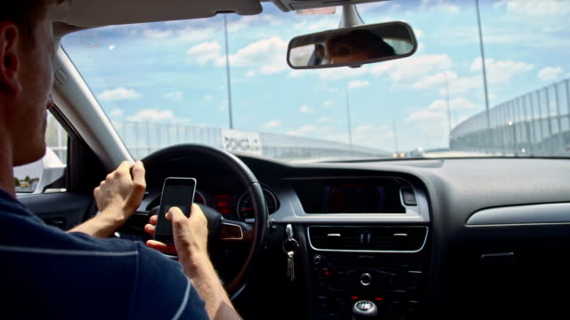 SLO MO Using phone while driving on the bridge video
