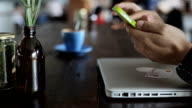 Using smart phone at coffee shop video