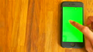 Using smart Phone on Wooden table video