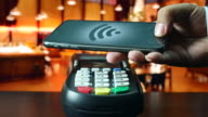 Using smart phone paying in the restaurant, Contactless payment video