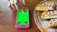 Using smart Phone Which Laying on Wooden Table at restaurant video