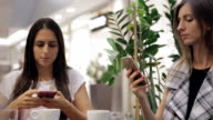 Using smartphone in a Cafe video