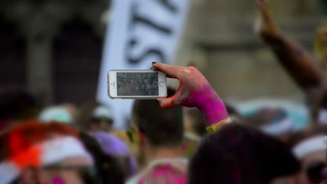 using smartphone to film at outdoor party video