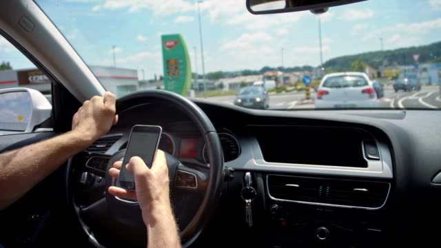 SLO MO Using smartphone while driving in a traffic video