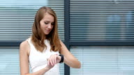 Using Smartwatch by Beautiful Girl, Outside Office video