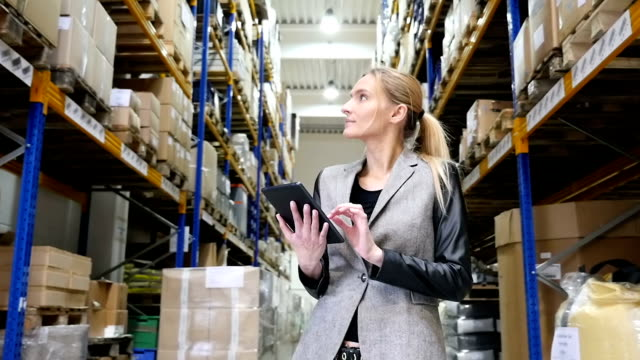 Using tablet and examining the orders in warehouse video