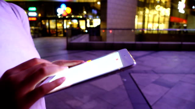 Using tablet at night street video