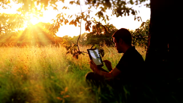 Using Tablet Computer In The Great Outdoors video