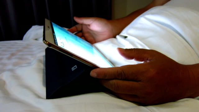 using tablet on bed video