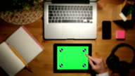 Using Tablet PC with a Green Screen on a Workplace . Aerial View video