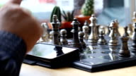 using touch screen phone during play chess video