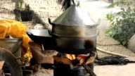 Using traditional cooking stoves. video