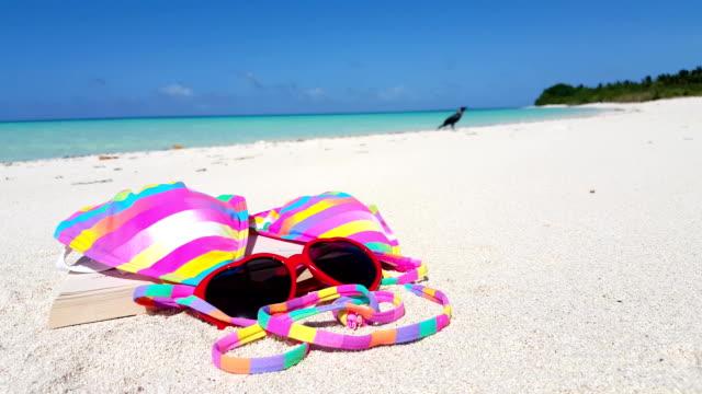 v00003 Maldives beautiful beach background white sandy tropical paradise island with blue sky sea water ocean 4k pink bikini red sunglasses video