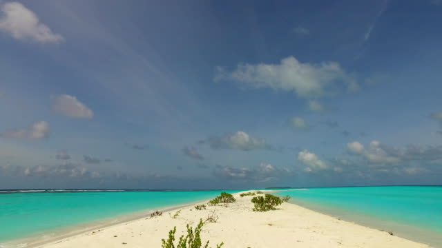 v00121 Maldives beautiful beach background white sandy tropical paradise island with blue sky sea water ocean 4k sandbank video
