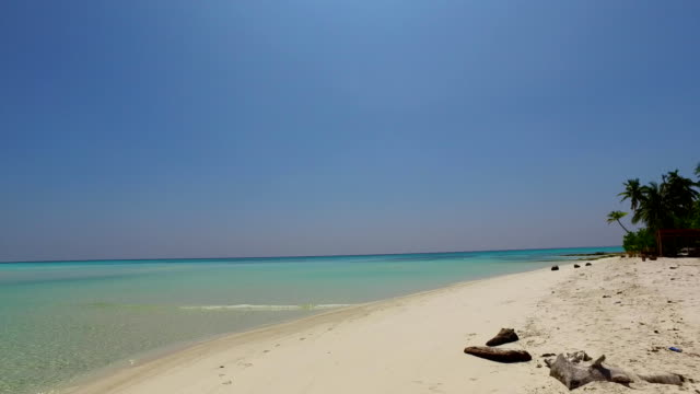 v01026 Maldives beautiful beach background white sandy tropical paradise island with blue sky sea water ocean 4k video