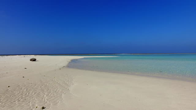 v01044 Maldives beautiful beach background white sandy tropical paradise island with blue sky sea water ocean 4k video